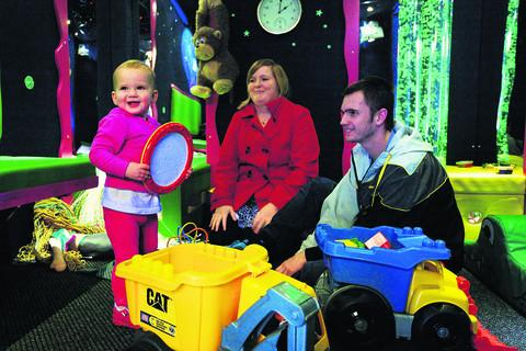 The Oxfordshire Playbus toys prove a hit with 16-month-old Cara, pictured with parents Holly Savin and Shaun Rowbotham      Pictures: Mark Bassett, David Fleming and Damian Halliwell