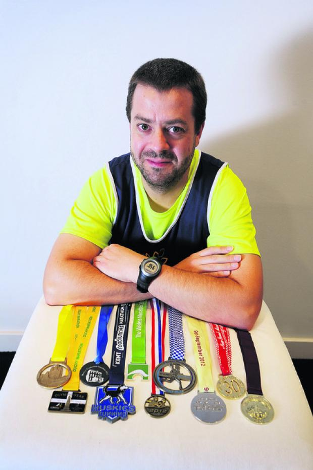 Ulen Neale with some of his marathon medals
