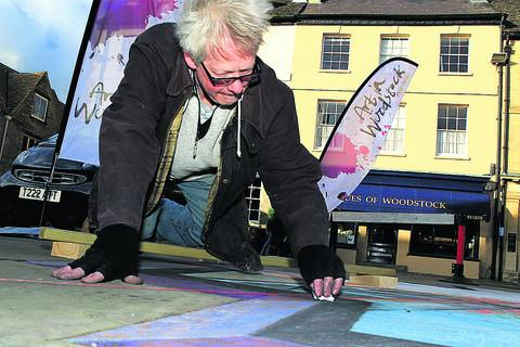 Artist Rod Cleasby at work in Woodstock's Market Square