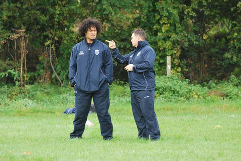 Tevita Vaikona (left) and Tony Benson assess players at the first trial