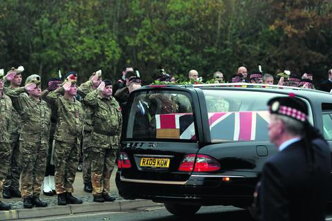 The hearse carrying the body of Captain Walter Barrie passes the Memorial Gardens in Carterton