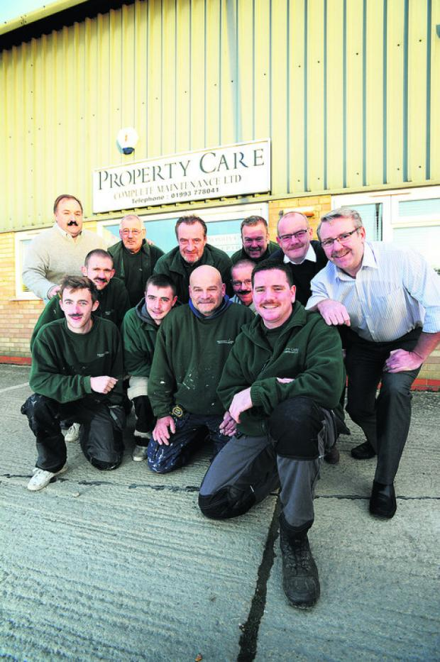 Witney Gazette: Damian Orman, front right, and his colleagues at Property Care Complete Maintenance Ltd have been taking part in the Movember charity moustache-growing fundraiser for his grandfather John Aldworth, proprietor of Autowork garage in Jericho
