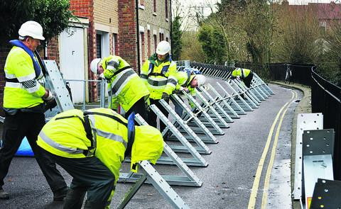 Witney Gazette: Flood barriers being installed at Osney Island in December 2012 during a previous flood warning period