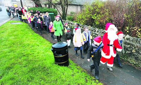 Santa - head teacher Lisa Rowe - leads Woodstock Primary School's walking bus