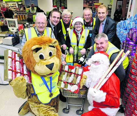 Witney Gazette: Pictured are, from left, Mick Townsend and John Roxby, of the Lions Club, Co-operative store manager Adam Quinton, Lions Paul Bevan, Liz Nason and Rob C