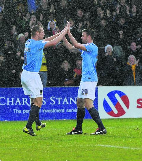 James Constable and Tom Craddock celebrate the former's opening goal