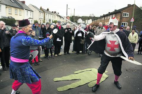 Headington Quarry Morris Dancers' Terry Phipps as the Turkish Knight and Alan Kimber-Nicholson as King George perform their traditional mummers play
