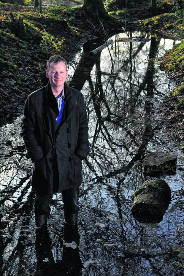Director Colin Shone in the Norman moat at Cogges Manor Farm which will be a main feature of a proposed children's adventure play area. Picture: OX56386 Ric Mellis