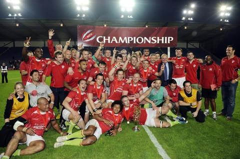 London Welsh celebrate winning the Championship at Oxford's Kassam Stadium