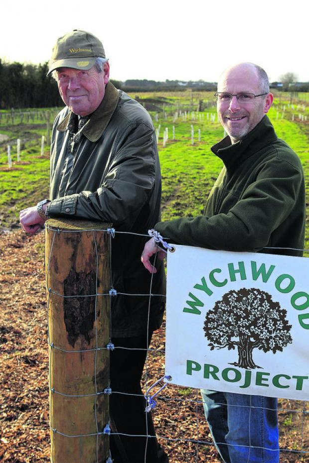 Witney Gazette: Trustee Roy Noble, left, and Wychwood Project director Nick Mottram at the entrance to the 22-acre woodland on the edge of Witney