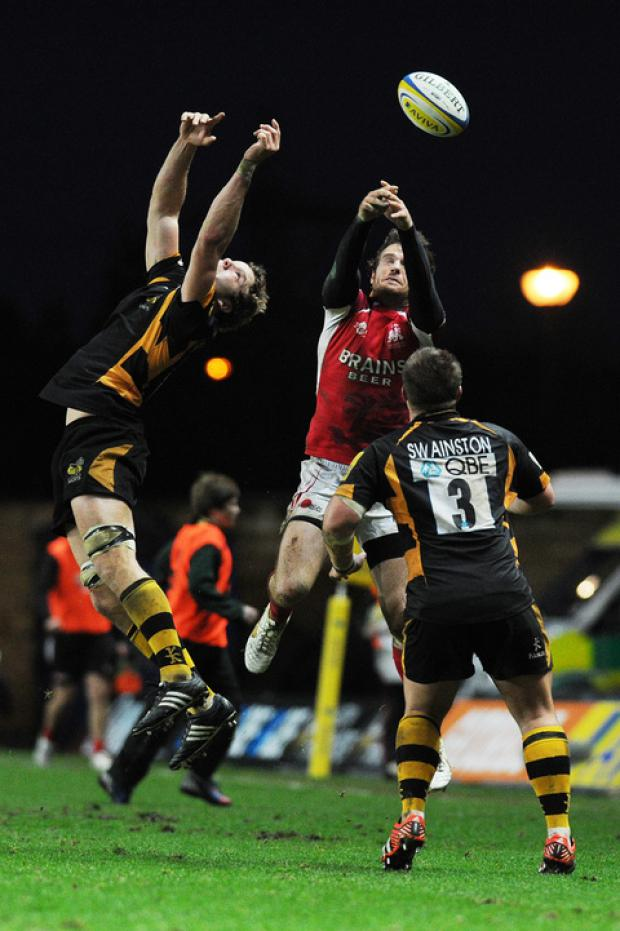 London Welsh centre Seb Jewell (middle) challenges for a high ball during last week's 34-15 defeat to Wasps at the Kassam Stadium