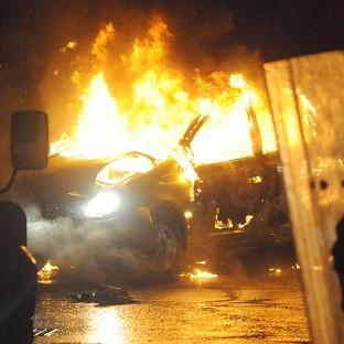A burned out car during disturbances which erupted in east Belfast