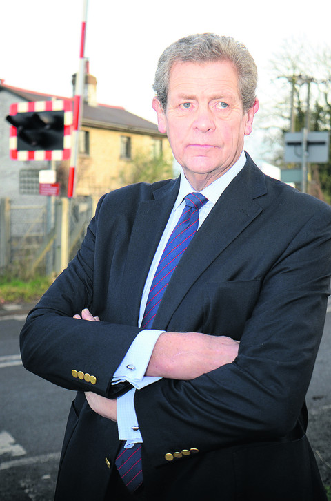 Parish council chairman Michael Gibbard at the level crossing in Sandy Lane. Picture: OX56625 Marc West