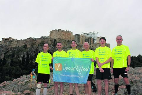 Left to right: Andy Nuttall, Nick Moglia, Simon Bennett, Rod Densham, Nic Yeoman and Nigel Davis holding the SpecialEffect flag
