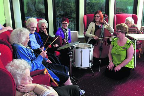 From left, Beech Haven Care Home residents Iris Clarke, 83, Marion Eales,101, and Alice Painting, 90, watched by Chipping Norton Theatre's Anne Gill, music therapist Becky Dowson and home manager Denise Herrin