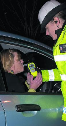 Amanda Cherry is breathalysed by Pc Sarah Holmwood after leaving an office party as part of the annual Christmas campaign by Thames Valley Police. She proved negative, as did all other drivers tested that night
