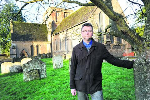 The Rev Charles Draper outside All Saints' Church in Faringdon