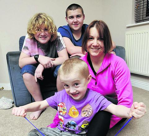 Witney Gazette: REASON TO RUN: Tracey Lewis, 39, with her boys Joe, five, and behind, 12-year-old Kai, left, and Matthew, 15