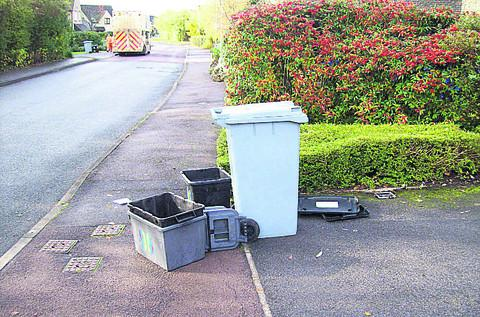 Chris Roger took this picture of his recycling boxes left obstructing the pavement outside his home after a collection last year