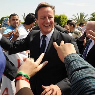 Prime Minister David Cameron told police recruits it was 'very good to be back' in Libya