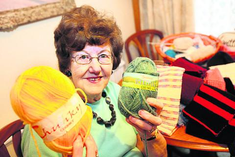 Pamela Clare, part of a group of Cowley knitters who make hundreds of hats. Pictur