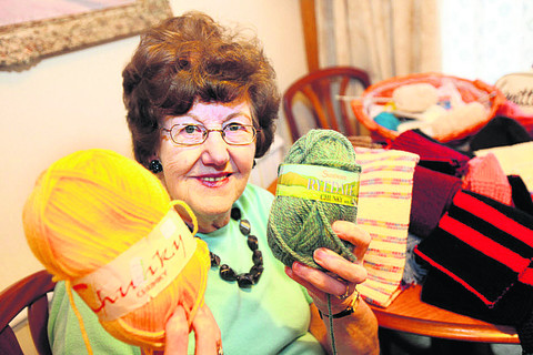 Pamela Clare, part of a group of Cowley knitters who make hundreds of hats. Picture: OX57111 Damian Halliwell