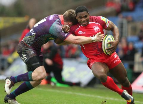 London Welsh wing Joe Ajuwa is tackled by Matthew Pewtner