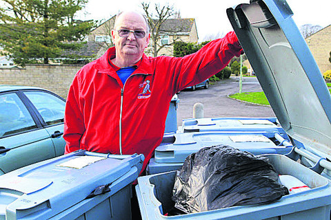Roger Godfrey with some of the bins in Pensclose, Witney
