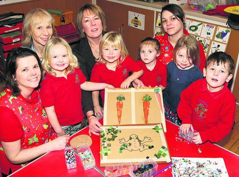 Pre-school manager Stella Johnson, Dr Sandra Hallett, of Cogges Surgery, Lindsey Thompson and pre-school assistant Emma Good, with some of the children