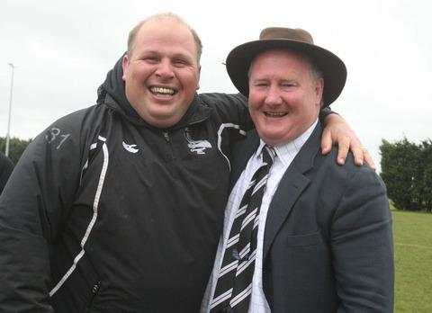 Jason Bowers (left) celebrates Chinnor's promotion to National 2 South with president Simon Vickers