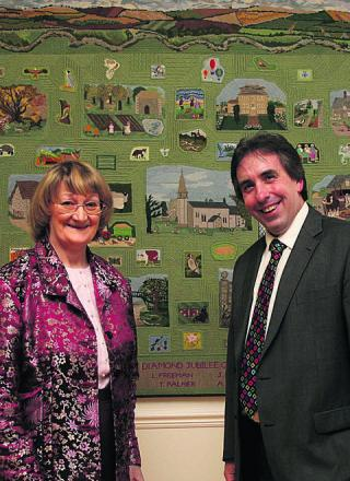 Catherine Hitchens and Richard Langridge with the wall-hanging