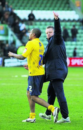 Chris Wilder acknowledges the travelling support after his Oxford United side got back to winning ways at Plymouth on Saturday