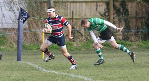 Grove wing Harry Carr rounds a Buckingham defender en route to the try line