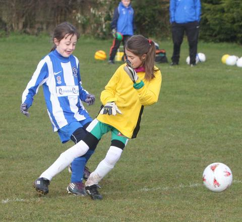 Stonesfield's Rachel Appleton beats keeper Raja Slavik-Ali for one of her four goals in the 4-0 win at home to Kidlington in the Under 10 League on Saturday