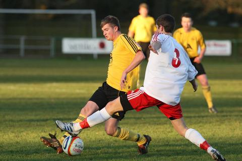 North Leigh striker John Mills (left) saw two chances go wide during their 3-1 defeat against Paulton Rovers in Division 1 South & West on Saturday