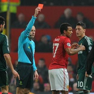 A teenage football fan rang 999 to report referee Cuneyt Cakir for sending off Manchester United player Nani