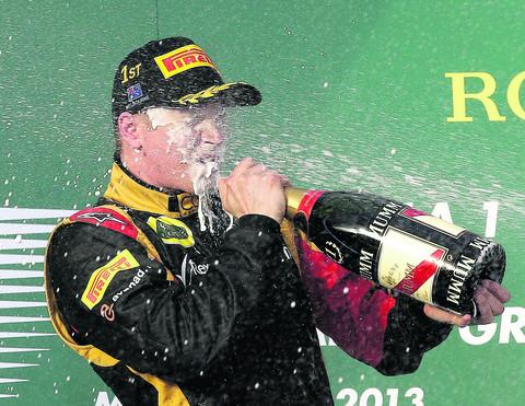 Kimi Raikkonen enjoys the post-race celebrations