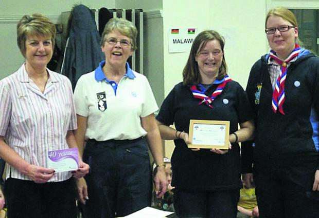 From left, Mandy Collicutt, Witney 1 area district commissioner Susan Wass, Ally Warren and Lizzie McLoone