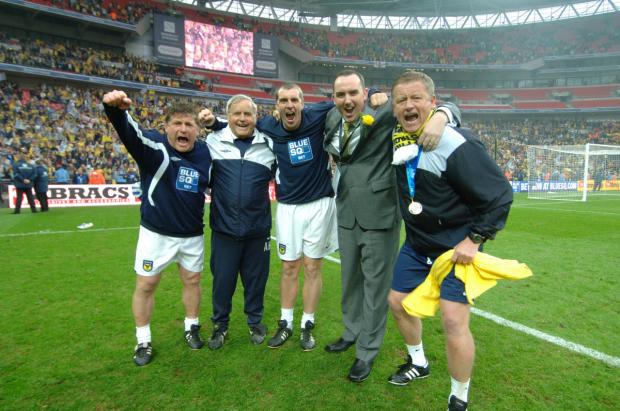 Witney Gazette: Chris Wilder celebrates winning promotion at Wembley with his backroom team and chairman Kelvin Thomas