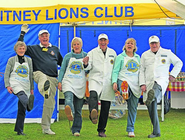 Members of the Lions' pig roast team, from left, Diane Hicks, Peter Lovell, Jill Attewell, John Dickinson, Sue Lovell and Colin Young