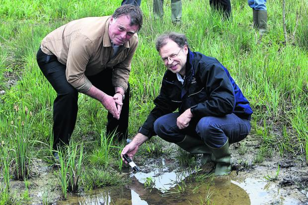 Oxford East MP Andrew Smith and charity director Jeremy Biggs at the nature reserve at Pinkhill Meadow, Farmoor
