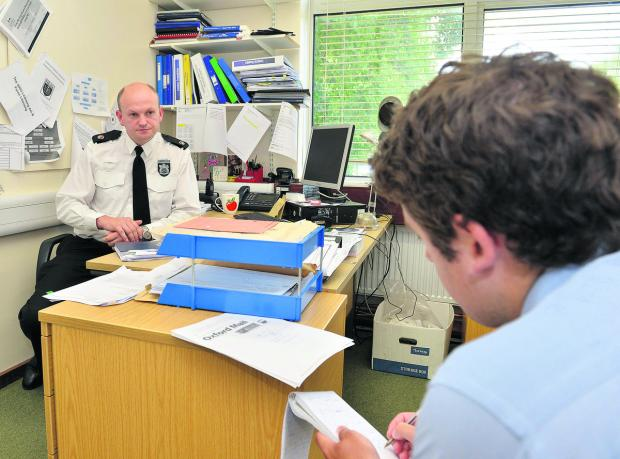 Colin Paine, Superintendent for West Oxfordshire and Cherwell, speaking at Witney Police Station about the closures of police stations to Oxford Mail reporter Ben Wilkinson. Picture OX60674 Simon Williams