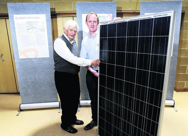 Dr Fred Wright, left, with Tom Illsley, of Solarcentury, and a solar power module