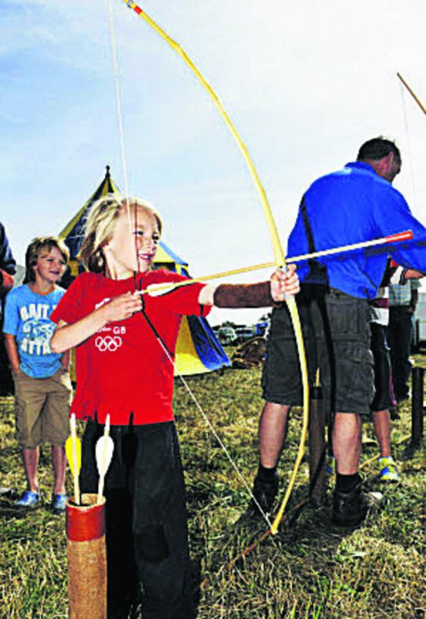 Witney Gazette: Ollie Ball, seven, right, from Milton-under-Wychwood was one of those who took part in the archery