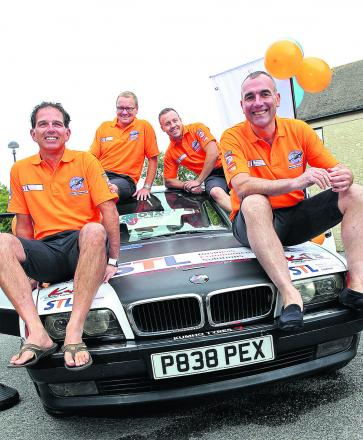 From left are Richard Ash, Philip Donigan, Steve Evins and Brendan Cross with their car