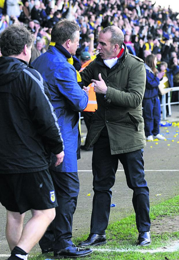 Witney Gazette: Paolo Di Canio has words with Oxford United boss Chris Wilder at the Kassam Stadium in March 2012 during his spell at Swindon