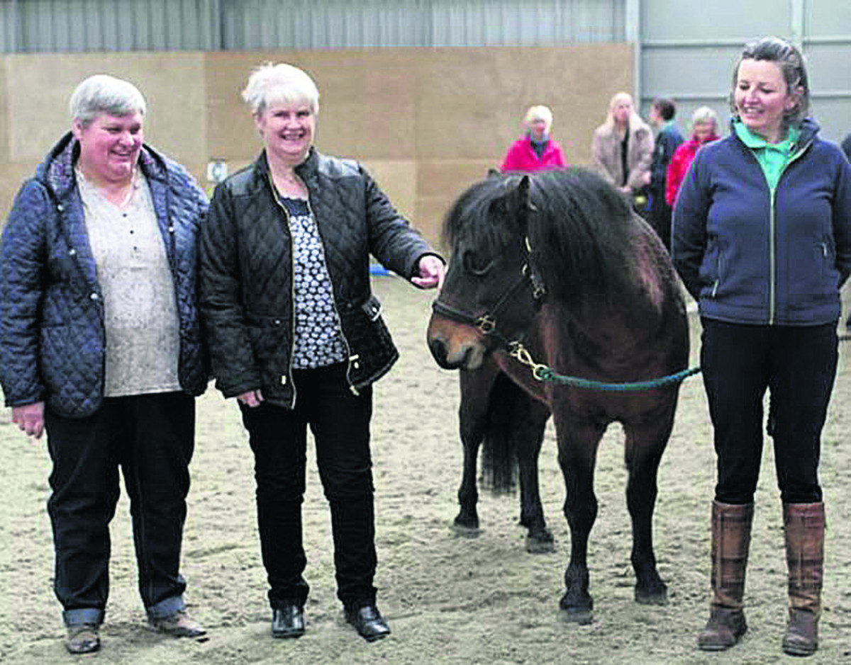 Kipper with, from left, Sue Leach, Nathalie Newell of Witney's Co-op store and riding instructor Kay Alty