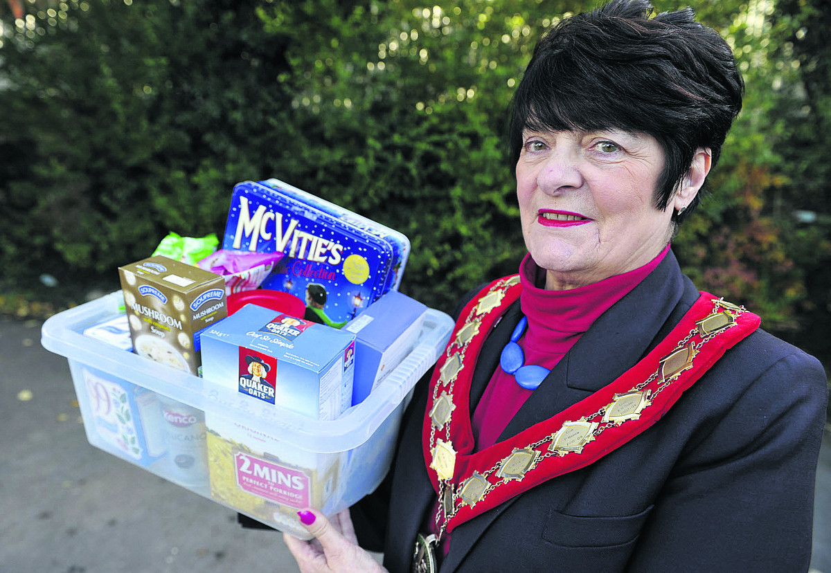 Carterton mayor Lynn Little with produce for the new food bank coming to the town