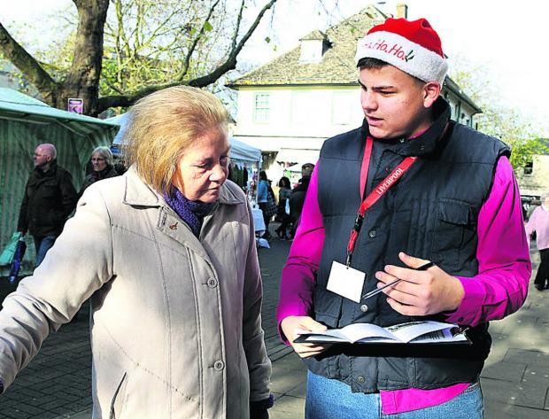 Kieran Butler, right, asks Lynda Jakeway to sign a petition protesting against the possible closure of children's centres and youth hubs