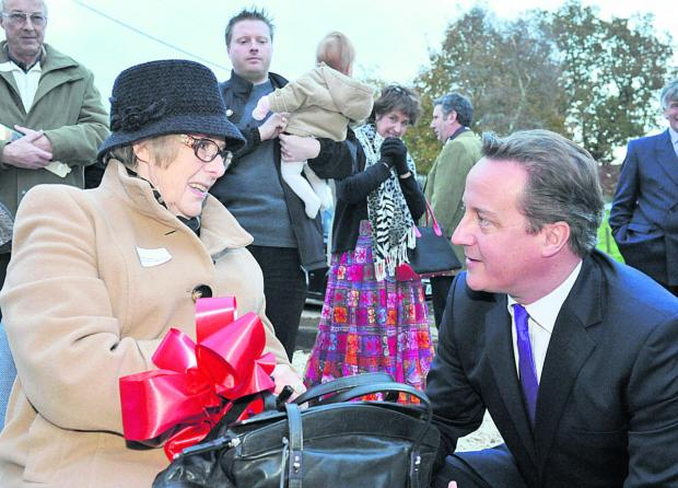 David Cameron talks to resident Phyllis Broome at the opening of South Leigh Village Hall
